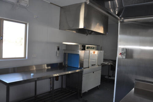 Happy Tappy Commercial Kitchens Gallery - 038 Stainless Steel Table with Overhead Exhaust and Window